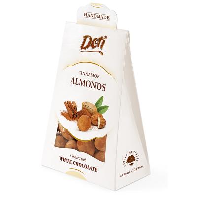 Бонбони DOTI бадеми в бял шоколад и канела